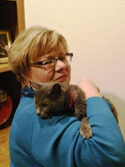 Nadine the cat returned to the Sheboygan home of Cheri Stocker on Wednesday. The cat had escaped from her home on Christmas Eve and turned up in southwest Florida nearly two months later.
