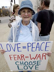Quaker, activist Sherry Hutchinson holds a peace  at Nollen Plaza in 2006.