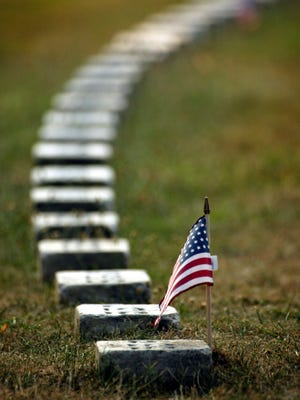 Stones marking the graves of unknown soldiers are seen Saturday, July 20, 2002, at the Gettysburg National Cemetery in Gettysburg, Pennsylvania.