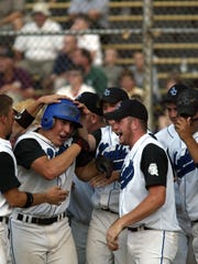 Oak Creek's Tony Harper (center) was one of the most dominant players in the area during his senior season in 2003, after which he was drafted in the 11th round by the Los Angeles Dodgers.