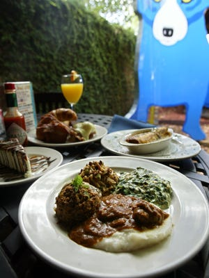 Brunch at Blue Dog Cafe includes unlimited food and mimosas. The well-known Cajun restaurant has filed for bankruptcy and will restructure with a new menu and chef.