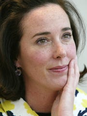 This May 13, 2004 photo shows designer Kate Spade during an interview in New York. Law enforcement officials say Tuesday, June 5, 2018, that New York fashion designer Kate Spade has been found dead in her apartment in an apparent suicide. (AP Photo/Bebeto Matthews, File) ORG XMIT: NYET203