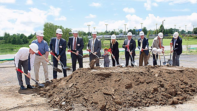 Rivergate Toyota staff and corporate members of Toyota break ground on Rivergate's new dealership.