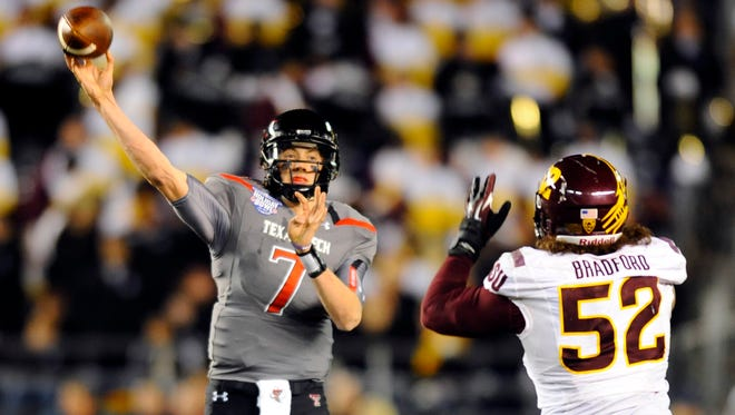Texas Tech Red Raiders quarterback Davis Webb (7) passes the ball during the second half against the Arizona State Sun Devils in the Holiday Bowl at Qualcomm Stadium.