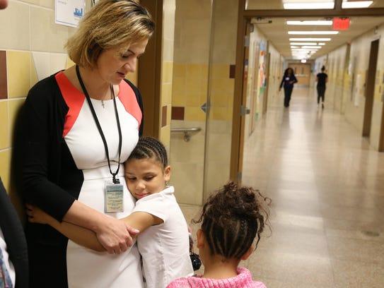 Caterina Leone-Mannio, principal at School 17, gets