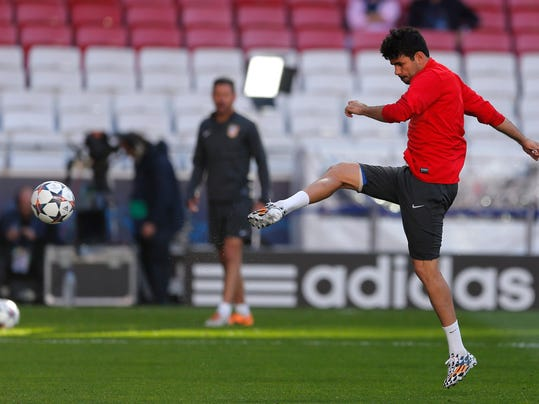Atletico's Diego Costa, kicks the ball, during a training session ahead of Saturday's Champions League final soccer match between Real Madrid and Atletico Madrid, in Luz stadium in Lisbon, Portugal, Friday, May 23, 2014. (AP Photo/Andres Kudacki)