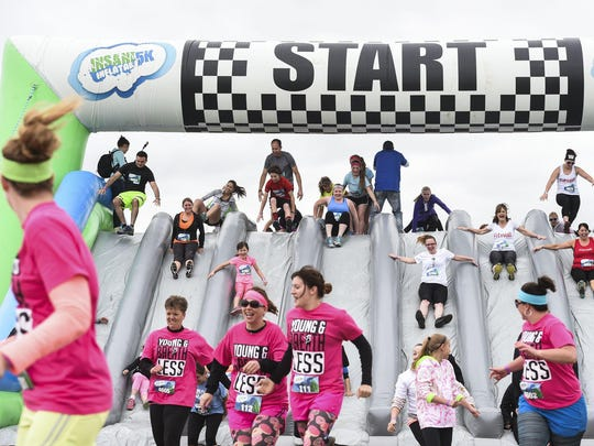 Runners in Loveland, Colo., begin the Insane Inflatable