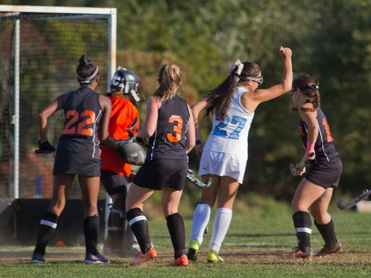 Freeehold Township's Samantha Perskin celebrates after scoring her team's first goal during Middletown North Field Hockey vs Freehold Township in SCT tourney action in Freehold Township on October 2015.