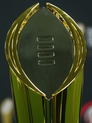 Tthe College Football Playoff National Championship trophy.