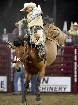 Dusty Hausauer, of ND, rides in the bareback riding competition during the 2016 Sioux Falls Premier Rodeo at the Denny Sanford Premier Center.