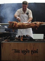 Chef Tim Love grills at The Woodshed, an establishment he owns in Fort Worth, Texas.