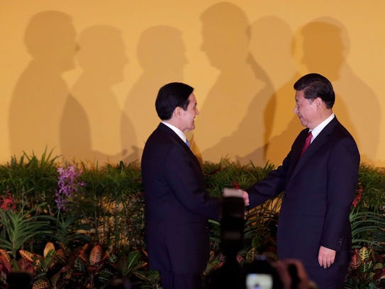 Chinese President Xi Jinping, right,  and Taiwanese
