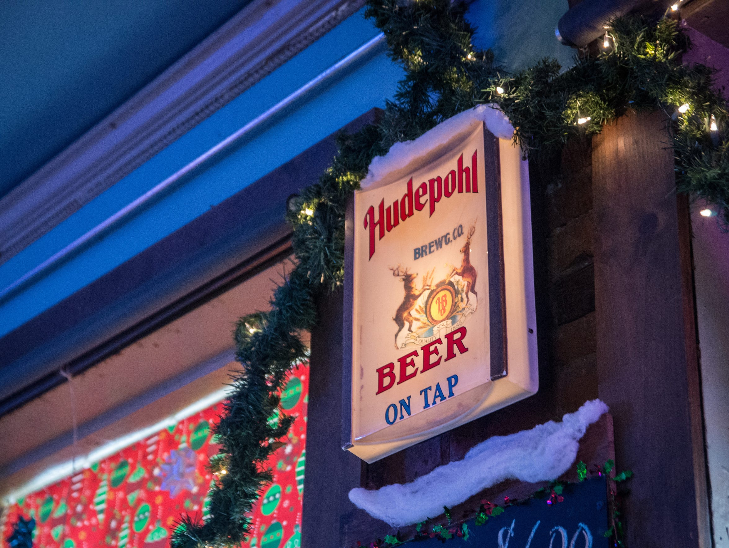 A Hudepohl sign hanging in Milton's, a bar on Sycamore