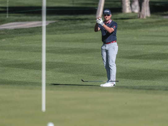 Austin Cook reacts to a missed birdie on 18 at La Quinta