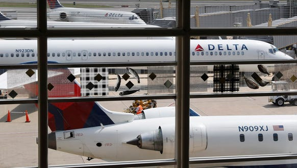 Delta Air Lines planes are parked Aug. 8, 2016, at
