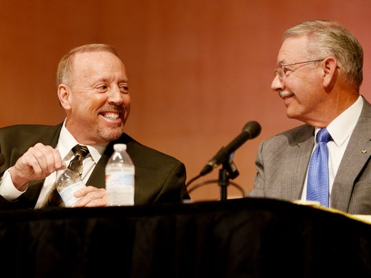 Lee Savage, left, and Jim Taliaferro talk during a break at the Wednesday evening mayoral forum at Centenary College.