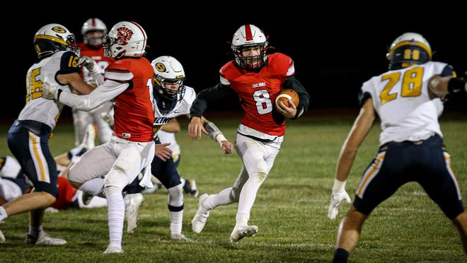 Photo by DANA STIEFEL Monroe's Jacob Blosser looks for an opening during third quarter action earlier this season. Blosser had a big day Saturday.