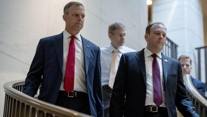 Republican lawmakers, from left, Rep. Scott Perry, R-Carroll Township, Rep. Jim Jordan, R-Ohio, and Rep. Lee Zeldin R-N.Y., arrive Monday for a closed-door meeting on Capitol Hill.