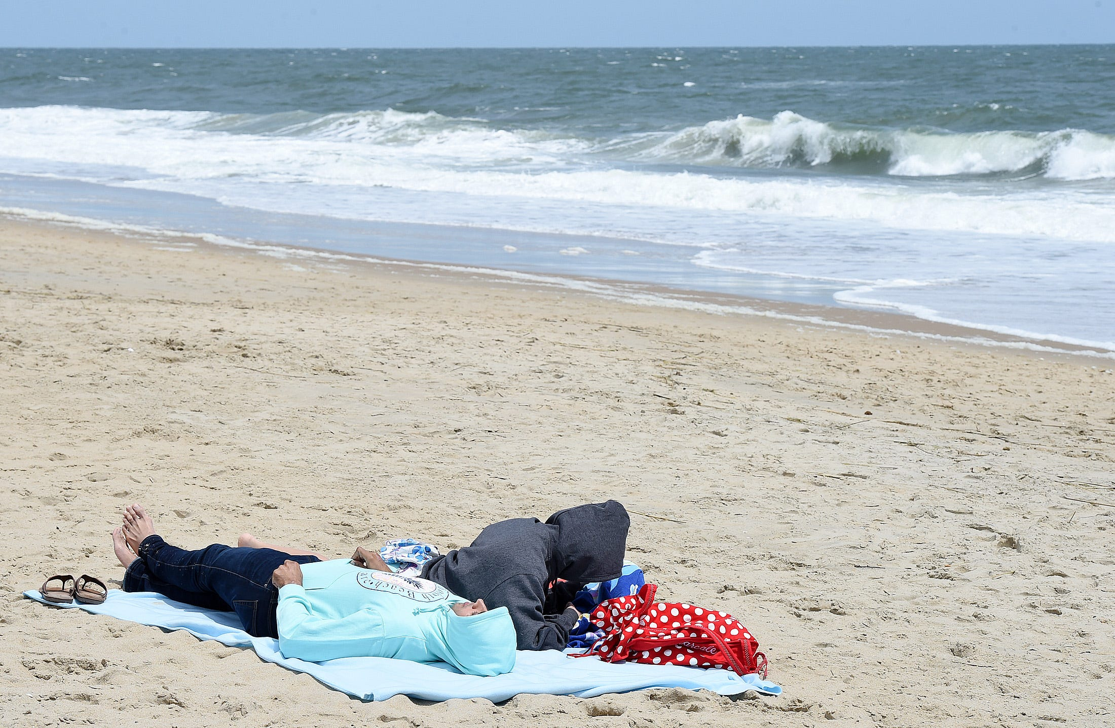 Cool and windy weather held back the beach crowds & With tourists incoming some throw shade at Rehoboth over beach ...
