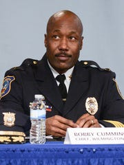 """Wilmington Police Chief Bobby Cummings speaks at a community forum on Dec. 18. He credits Operation Disrupt with helping reduce shootings and homicides. """"It's been very positive,"""" he says."""