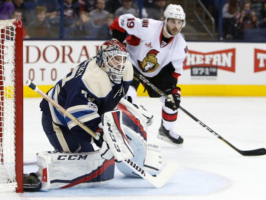 Columbus Blue Jackets' Sergei Bobrovsky, left, of Russia, protects the net as Ottawa Senators' Derick Brassard looks for the puck during the first period of an NHL hockey game Thursday, Jan. 19, 2017, in Columbus, Ohio. (AP Photo/Jay LaPrete)