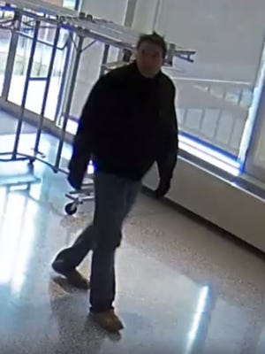 Livonia police say this man is accused of stealing a tapistry depicting the Last Supper from Madonna University.