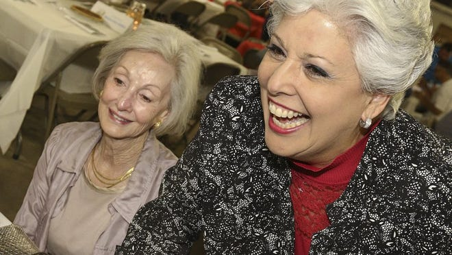 GEORGE TULEY/SPECIAL TO THE CALLER-TIMES Mayor Nelda Martinez (right) greets the people sitting with Alice Sallee at the Education Advocates Awards dinner Thursday, June 16, 2016, at the Al Amin Shriners Pavilion in Corpus Christi.