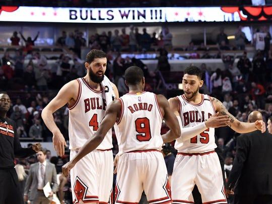 Denzel Valentine, right, celebrates during the Chicago Bulls' win over the Atlanta Hawks in April with teammates Rajon Rondo and Nikola Mirotic.