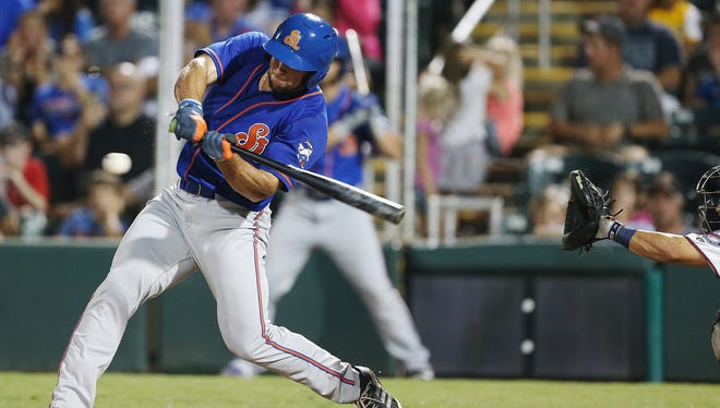 St. Lucie Mets outfielder Tim Tebow bats against the Fort Myers Miracle on Friday at Hammond Stadium in Fort Myers.