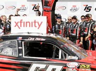 Chris Buescher celebrates in victory lane after winning the NASCAR Xfinity Series auto race, Sunday, May 17, 2015, at Iowa Speedway in Newton, Iowa. (AP Photo/Charlie Neibergall)