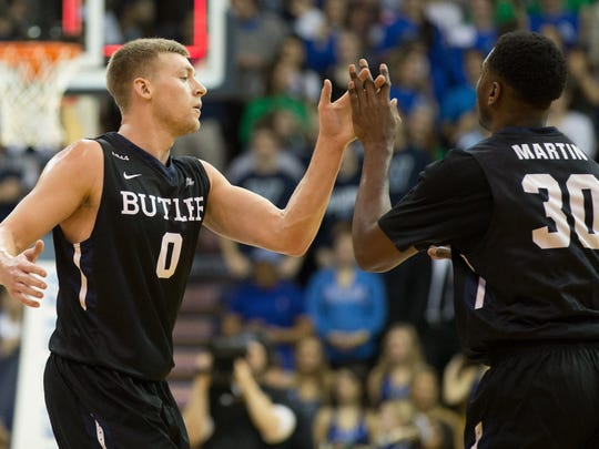 Butler Bulldogs forward Kelan Martin (30) celebrates with forward Austin Etherington (0) after a three pointer buzzer beater at the end of the first half at The Pavilion.