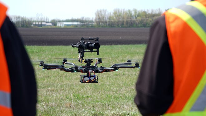 UAV pilots Jared Langley, 31, and Cory Vinger, 24, work together to fly a FreeFly ALTA 8 octocopter in Grand Forks N.D. This drone can carry everything from high-resolution cameras to thermal imaging equipment, flying on pre-programmed inspection routes for 20 minutes at a time.
