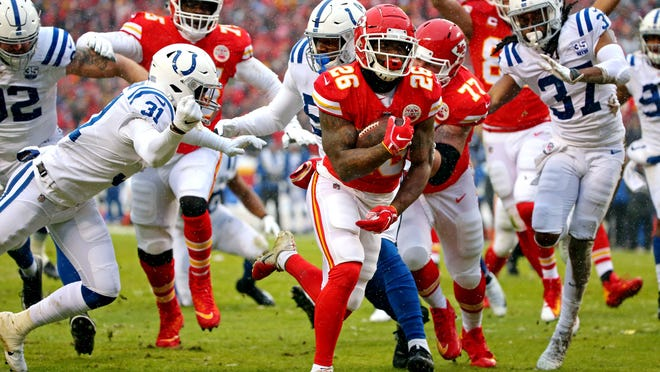 Jan 12, 2019; Kansas City, MO, USA; Kansas City Chiefs running back Damien Williams (26) scores a touchdown  during the first quarter against the Indianapolis Colts in an AFC Divisional playoff football game at Arrowhead Stadium. Mandatory Credit: Jay Biggerstaff-USA TODAY Sports