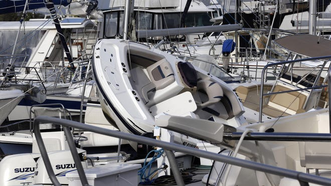 Boats are piled on each other at the Southport Marina following the effects of Hurricane Isaias in Southport Tuesday.