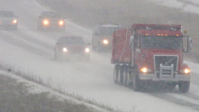 A dump truck leads eastbound traffic on State Highway 23 Monday December 28, 2015 in Sheboygan.