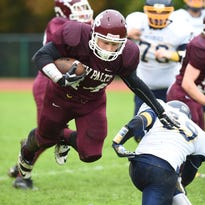 New Paltz's Jimmy Verney breaks free from Highland's William Sickles during Friday's game at New Paltz.