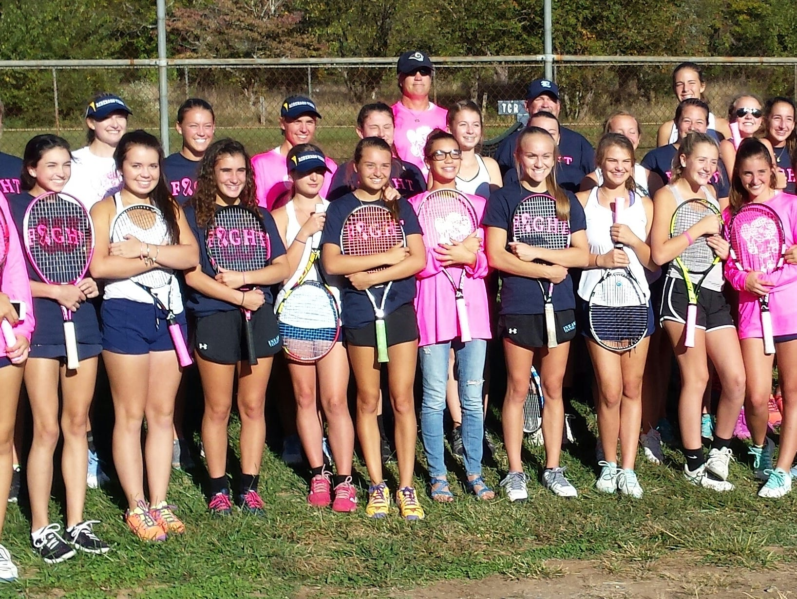 Enka and Roberson tennis players are pictured together following their Oct. 6 match for breast cancer awareness ini Skyland. The Rams won, 9-0.