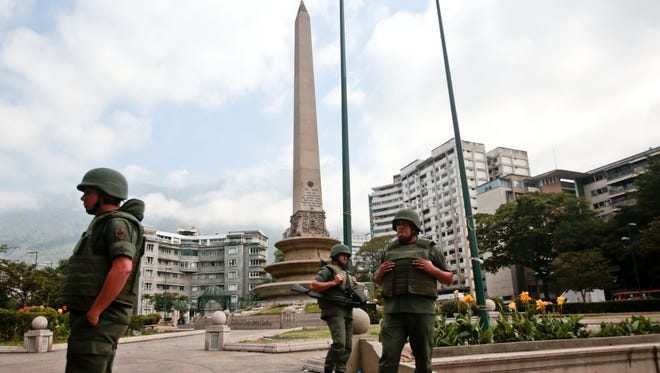 Government security forces took control of a Caracas plaza and surrounding neighborhoods Monday morning that had become the center of student-led protests.