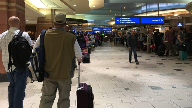 Two busy security checkpoints at Phoenix Sky Harbor International Airport and the PHX Sky Train are closed this morning as Phoenix police check out a suspicious package.