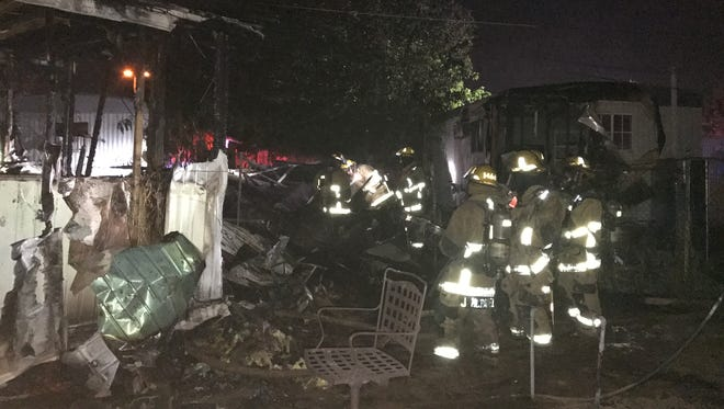 Fire crews fought a shed fire that quickly spread in a mobile-home park.