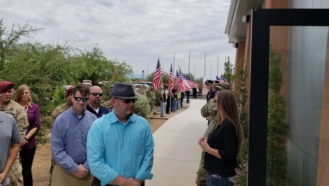 People stand in line to attend the Sierra Vista funeral of Pfc. Jimmie Smith, who died homeless.