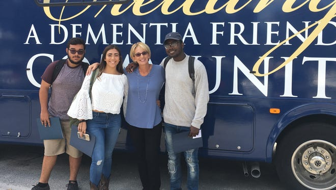 Educator Laurie Wckoff (center) and students from Indian River Charter High School participate in dementia friendly community training.
