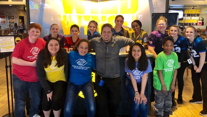 Pictured in back from left: Buffalo Wild Wings staff Arriana Chapin, Alex Denk, Payton Walgenbach, Ally Francis, Selom Gengler, Abbi Pflum, Hailey Walgenbach, and Kaitlyn Heiman; front from left: Club members Taylor Hill, Yajaira Lopez and Paulina Lopez; Scott Chamberlain, general manager for Buffalo Wild Wings in Fond du Lac; and Club members Martha Martinez and Prince Olanrewaju.