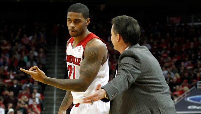 University of Louisville head coach Rick Pitino talks with Chane Behanan (21) during their game against the University of Southern Miss during the second half of play at the KFC Yum! Centers in Louisville, Kentucky.           November 29, 2013