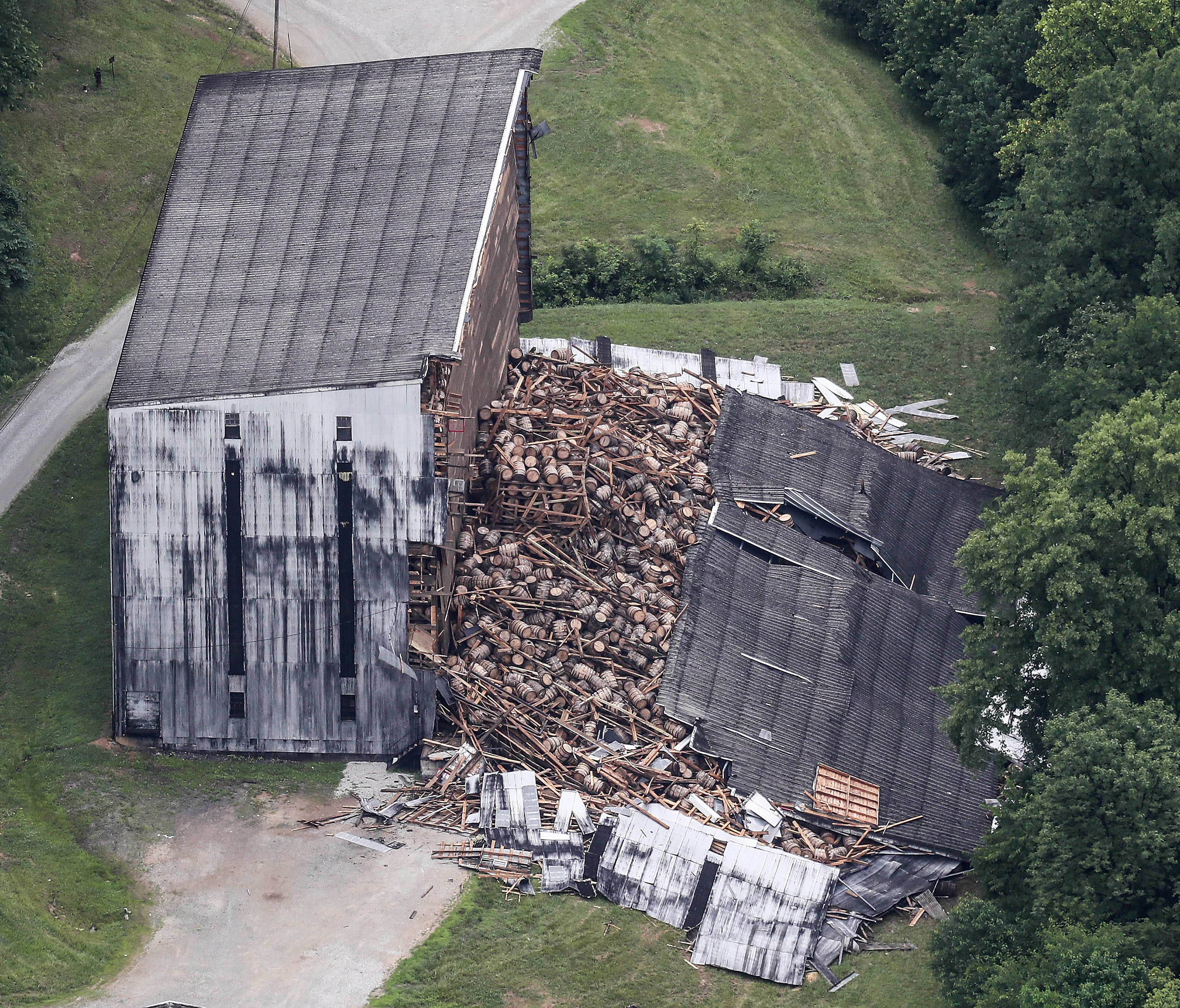 A partially-collapsed bourbon warehouse at the Barton 1792 distillery in Bardstown, Kentucky.  June 23, 2018
