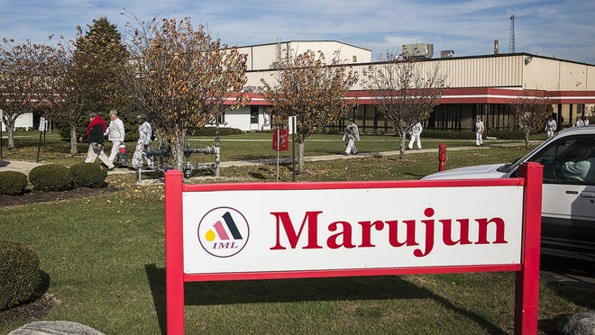 First-shift employees exit the Marujun factory in Winchester Wednesday, Nov. 11, 2015. The factory, which employs more than 750 workers, will be closed by next November.