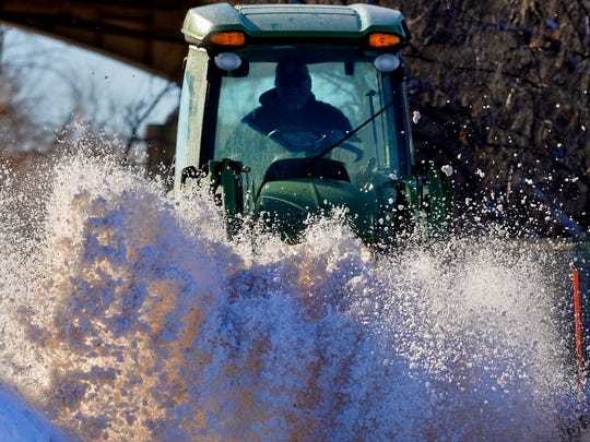 A snow sweeper clears River's Edge Trail at Oddfellows