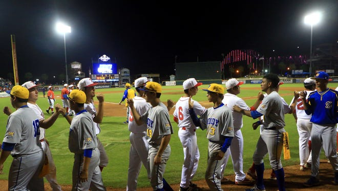 Moody players shake hands with Ray players at the end of game 1 of the Region IV-5A finals Thursday, June 1 ,2017, at Whataburger Field in Corpus Christi.
