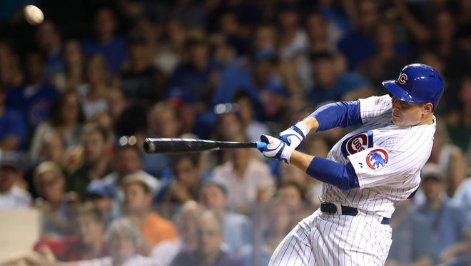 Chicago Cubs first baseman Anthony Rizzo hits one of his two home runs Tuesday against San Diego at Wrigley Field.