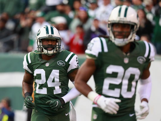 Darrelle Revis #24 of the New York Jets and Marcus Williams #20 are seen in the fourth quarter against the Baltimore Ravens at MetLife Stadium on October 23, 2016 in East Rutherford, New Jersey.